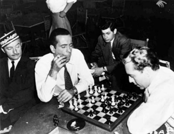 "Claude Rains watches Humphrey Bogart and Paul Henreid play chess on the set of ""Casablanca"" (1942)"