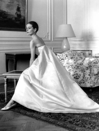 1958 at a dress fitting with Hubert de Givenchy