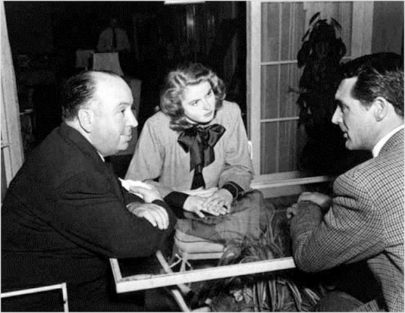 Alfred Hitchcock, Ingrid Bergman and Cary Grant during the shooting of Notorious